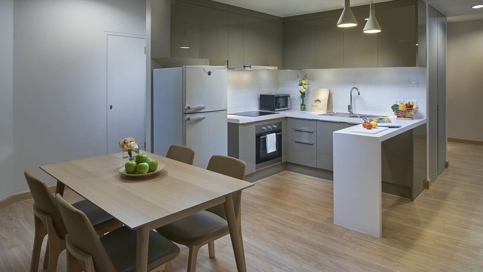 Two Bedroom Deluxe - Kitchen and dining area
